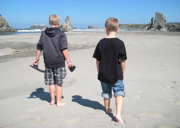 2 Boys Walking On The Beach
